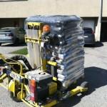 caisse avec chariot embarqué pour la livraison de palettes